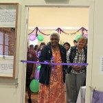 Bessie Bond cuts the ribbon to open the Exhibition