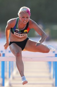 NEWCASTLE, AUSTRALIA - JANUARY 18:  Shannon McCann of Western Australia wins the womens 100m hurdles during the Hunter Track Classic on January 18, 2014 in Newcastle, Australia.  (Photo by Tony Feder/Getty Images)