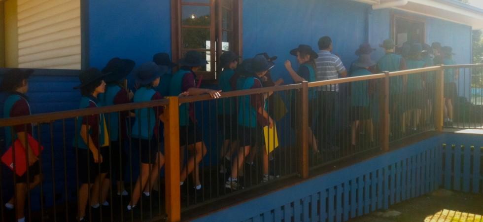 Kids lining up for art workshop